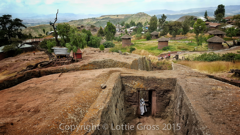 A priest readin prayers at the entrance to churches, Lalibela, Ethiopia